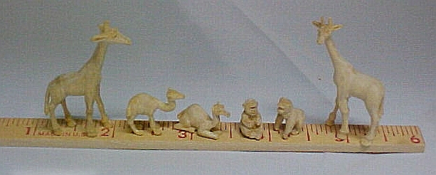 Carved unpainted Ark animals
