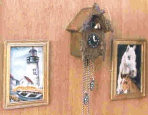 hand carved cuckoo-clock with paintings