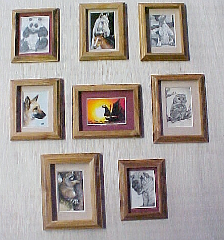 Miniature drawings and paintings, matted and framed.