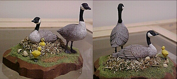hand carved wood Canada goose family