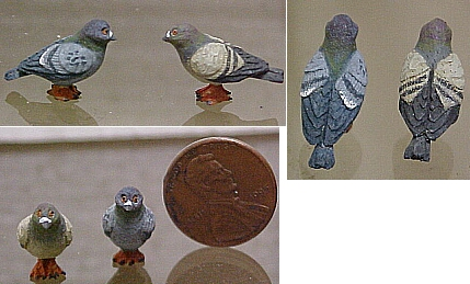 Hand carved hand painted wood pigeons